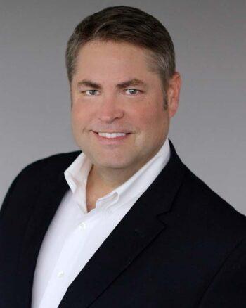 headshot of Dr. Andrew Mayo