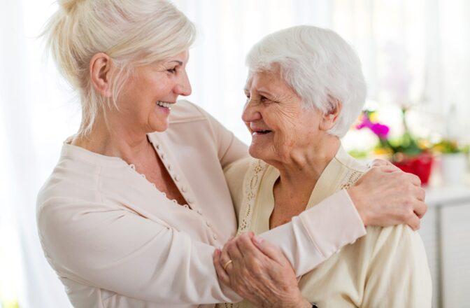 two mature women embracing
