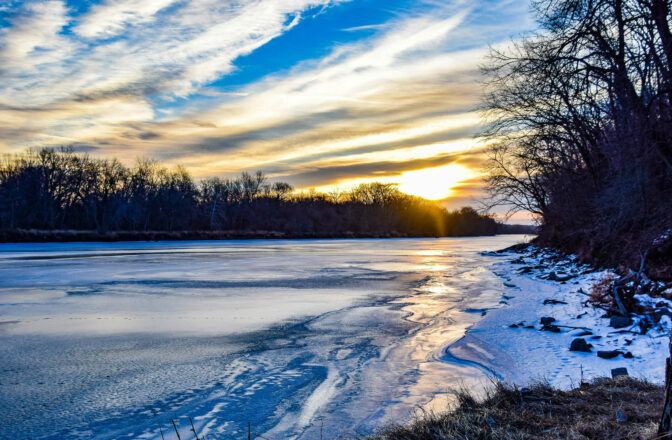 winter lakeside scene at sunset