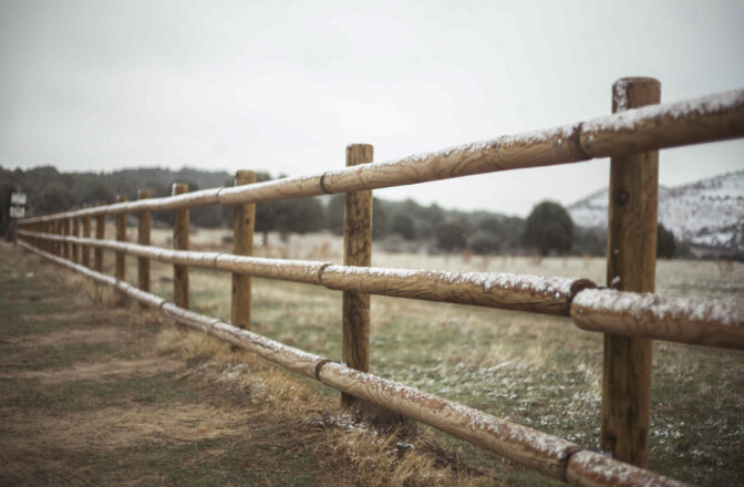 wood fence dusted with snow