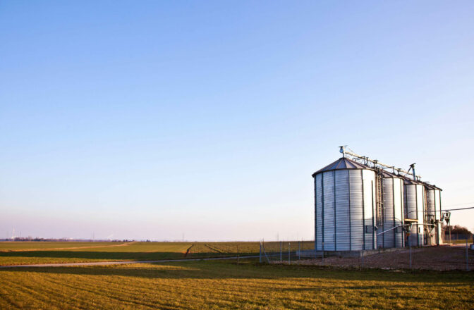 open field and sky with new grain bins