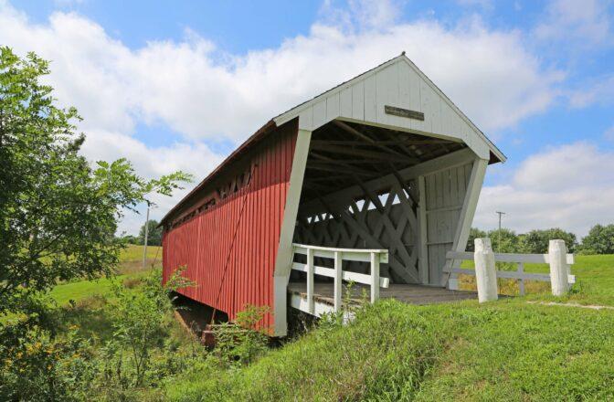 covered bridge on bright day