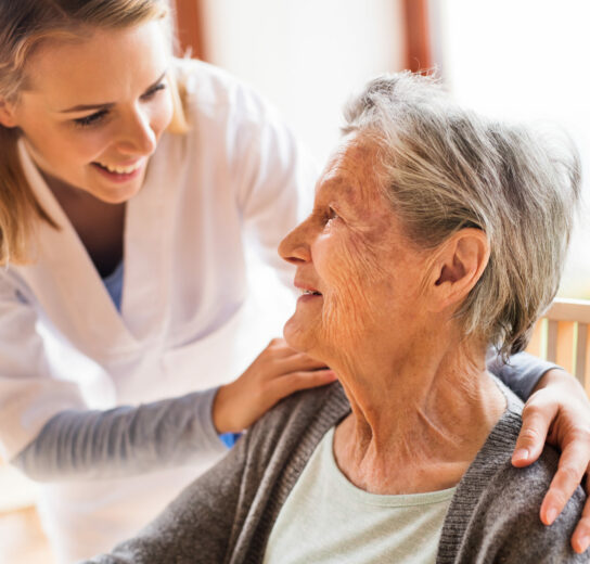 mature woman talking to a female healthcare professional